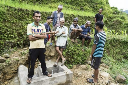 Villagers at work to restore the water supply