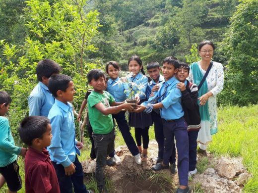 Students holding plant